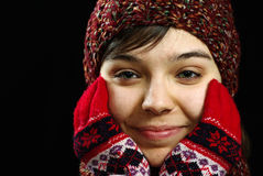 Girl in woolen mittens and hat Stock Image