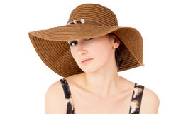 The girl wore a big hat Stock Photos