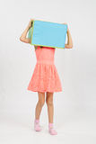 The girl wore a box on his head Stock Photography