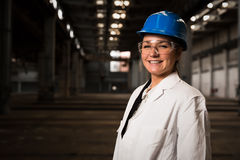 Girl worker in the factory Stock Photos