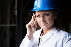 Girl worker in the factory Royalty Free Stock Photos