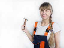 Girl worker with the tool Royalty Free Stock Image