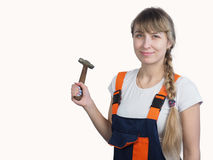 Girl worker with the tool Royalty Free Stock Photos