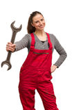 Girl worker with wrench Royalty Free Stock Photos
