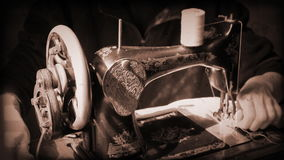 Girl working at an antique sewing machine stock footage