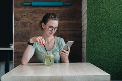 Girl working, blogging, chatting, learning online, reading e-book. Online education. Social media, network. Royalty Free Stock Image