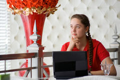 Girl working in cafe Royalty Free Stock Images