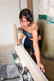 Girl working in the carpentry shop Stock Photos
