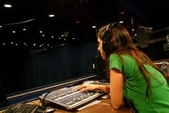 Girl working on console. Girl working on lighting console during a show or doing a lighting intensity session Stock Photos