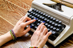 Girl working at contemporary typing machine Royalty Free Stock Photo