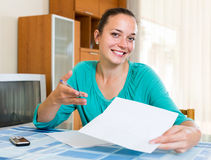 Girl working with documents at home Stock Photography
