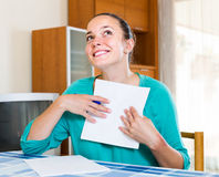 Girl working with documents at home Royalty Free Stock Image