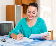 Girl working with documents at home Royalty Free Stock Images