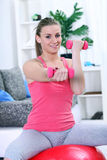 Girl working with fitness ball and dumbbell Royalty Free Stock Images