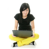 Girl working on her laptop. Stock Images
