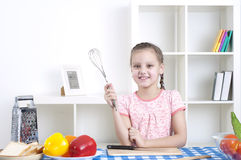 Girl working in the kitchen Stock Image
