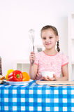 Girl working in the kitchen Royalty Free Stock Images