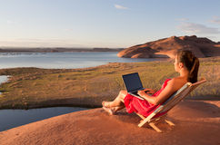 Girl Working while at Lake Powell Stock Images