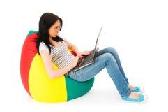 Girl working on laptop Stock Image