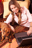 Girl working with laptop royalty free stock photography