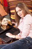 Girl working with laptop Stock Image