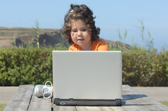 Girl working with laptop Stock Photography