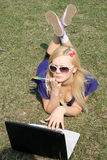 Girl working on a laptop. In a park Royalty Free Stock Photography