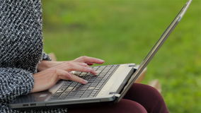 Girl working on laptop in the city park stock video footage