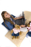 Girl working on laptop computer. Young girl working, playing on laptop computer stock image