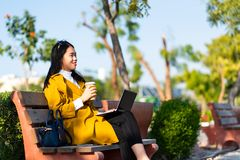 Girl working on laptop outdoors royalty free stock photos