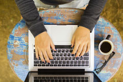 Girl working with laptop on a vintage wooden table Royalty Free Stock Photos