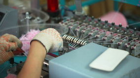 Girl working for machine by hand-knitting stock video footage