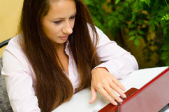 Girl working on notebook at home Stock Image