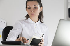 Girl working with numbers Stock Photos
