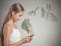 Girl working online on smart phone making earning money Royalty Free Stock Images