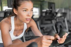 Free Girl Working Out Doing Cycling Class At Gym Royalty Free Stock Photography - 191958417