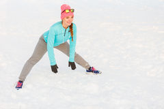 Girl working out in freezing temperatures. Exercising in subzero temperatures, fitness fashion health nature concept royalty free stock photography