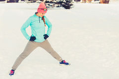 Girl working out in freezing temperatures. Exercising in subzero temperatures, fitness fashion health nature concept stock photos