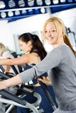 Girl working out at the gym Stock Images