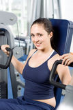 Girl working out in the gym royalty free stock image