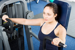 Girl working out in the gym royalty free stock photography