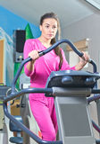 Girl working out in a gym Stock Photography
