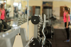 Girl working out in gym. royalty free stock image