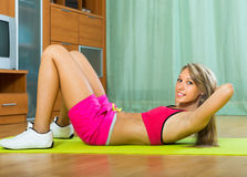 Girl working out indoor Royalty Free Stock Photos