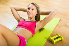 Girl working out indoor Royalty Free Stock Photography