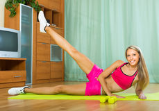 Girl working out indoor Royalty Free Stock Images