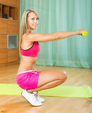 Girl working out indoor Royalty Free Stock Photo