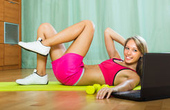 Girl working out with notebook in gym Stock Images
