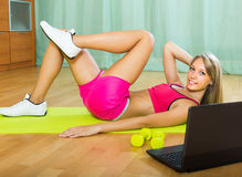 Girl working out with notebook Royalty Free Stock Photos