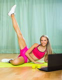 Girl working out with notebook Stock Image